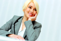 Closeup portrait of a cheerful businesswoman looking away Stock Image