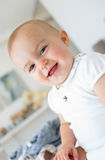 Closeup portrait of a cheerful cute baby Stock Photography