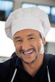 Closeup Portrait Of Cheerful Male Chef Stock Images