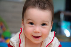 Closeup portrait of child, cute toddler girl with amazed smiling Stock Images