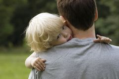 Closeup portrait of child on daddy's shoulder. Stock Image