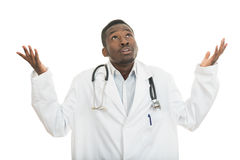 Closeup portrait of clueless black doctor health care professional, with stethoscope. stock images