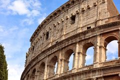 Closeup portrait of Coliseum building old wall with arch in Rome Royalty Free Stock Image