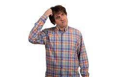 Closeup portrait of confused young man in checkered shirt. Stock Photos