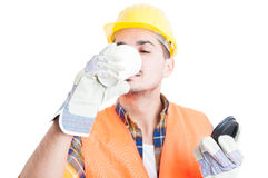 Closeup portrait of constructor drinking a coffee on his break Royalty Free Stock Image