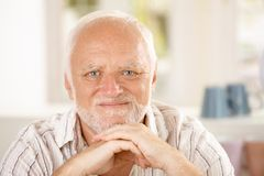 Closeup portrait of content senior. Man looking at camera stock photography