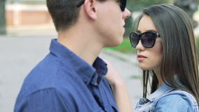 Closeup portrait of couple's profile's faces, looking each other. Slowly stock video footage