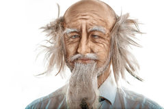 Closeup portrait of crazy oldman on white background Royalty Free Stock Images