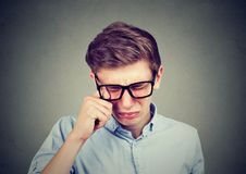 Closeup portrait of a crying teenager man in glasses. Closeup of a crying teenager man in glasses Royalty Free Stock Image