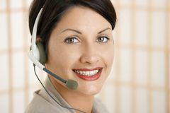 Closeup portrait of customer service operator. Closeup portrait of attractive customer service operator talking on headset Stock Photography
