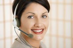 Closeup portrait of customer service operator. Closeup portrait of attractive customer service operator talking on headset stock photography