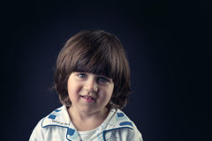 Closeup portrait of a cute adorable little kid smiling Stock Image
