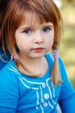 Closeup portrait of cute adorable little red-haired Caucasian girl child with blue eyes stock photography