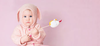 Closeup portrait of cute baby with blue eyes in knitted costume