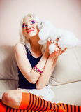Closeup portrait of cute blonde girl with rabbit toy Stock Images