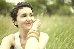 Cute girl on green field Stock Photo