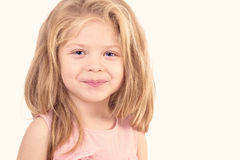 Closeup portrait of a cute liitle girl smiling Stock Photos