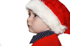 Closeup portrait of a cute little baby boy wearing red Santa Claus hat isolated on white background, traditional Christmas costume.  stock image