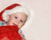 Closeup portrait of a cute little baby boy wearing red Santa Claus hat isolated on white background, traditional Christmas costume.  stock photos