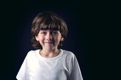 Closeup portrait of cute little boy laughing Royalty Free Stock Images