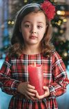 Closeup portrait of a cute, little girl holding a candle stock image