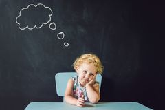 Closeup portrait of Cute little girl thinking deeply about something Copy space.  Royalty Free Stock Photo
