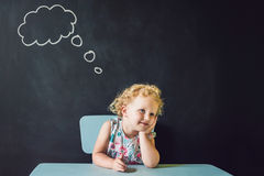 Closeup portrait of Cute little girl thinking deeply about something Copy space stock image