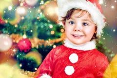 Closeup portrait of a cute little santa. Girl Royalty Free Stock Image