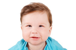 Closeup portrait of a cute smiling baby. Isolated on white background Stock Photos