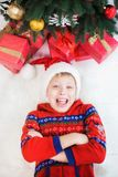 Cute surprised little child in holiday christmas interior Stock Images
