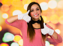 Closeup portrait of cute young girl clown mime holding thumbs up. Closeup portrait of cute young girl clown mime smiling holding thumbs up Royalty Free Stock Photo