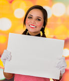Closeup portrait of cute young girl clown mime holding white paper Royalty Free Stock Photo