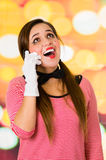 Closeup portrait of cute young girl clown mime using cell phone Stock Photography