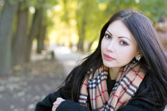 Cute young woman in autumn park Royalty Free Stock Images
