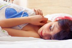 Closeup portrait of a cute young woman sleeping on the bed Royalty Free Stock Photos
