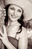 Closeup portrait of a cute young woman in straw hat Stock Photo