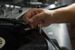 Closeup portrait of dj hands on equipment deck and Royalty Free Stock Photos