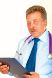 Closeup portrait of a  doctor with stethoscope holding folder Royalty Free Stock Photography