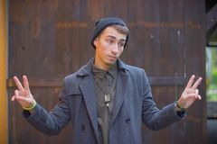 Closeup portrait of dumb, clueless young man, student, worker arms out asking what`s the problem stock photography