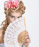 Portrait of the elegant woman. Closeup Portrait of the elegant woman with fan Royalty Free Stock Photos