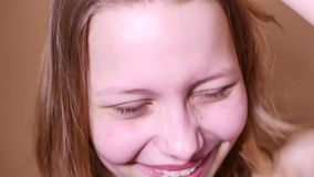 Closeup portrait of an emotional attractive laughing teen girl. 4K UHD stock footage