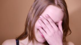 Closeup portrait of an emotional attractive laughing teen girl. 4K UHD stock video footage