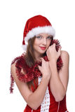 Closeup portrait of emotional girl in santa dress. Closeup portrait of beautiful emotional girl with green eyes weared in santa clause dress Royalty Free Stock Images