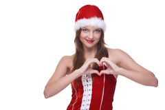 Closeup portrait of emotional girl in santa dress. Closeup portrait of beautiful emotional girl with green eyes weared in santa clause dress Royalty Free Stock Photography