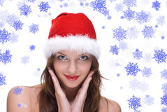 Closeup portrait of emotional girl in santa hat Royalty Free Stock Images