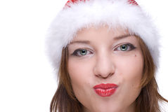Closeup portrait of emotional girl in santa hat Royalty Free Stock Image