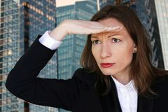 Hope Business woman looking forward with the hand in forehead office Executive stock image