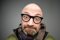 Closeup portrait of european funny mature man thinking trying hard to remember something looking confused. Closeup portrait of european funny bald mature man royalty free stock photography