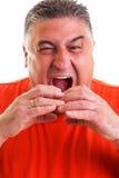 Closeup portrait of  an expressive man pretending to eat a sandw Stock Photos