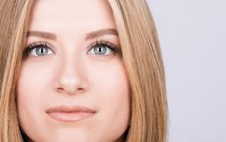 Closeup portrait of the face of a young woman, expressive eyes. Clear skin, blond hair stock photos
